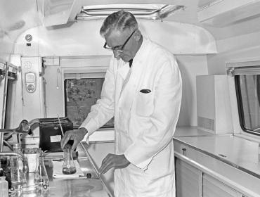 Mr Prins investigates samples in the sample and monitoring unit 1960