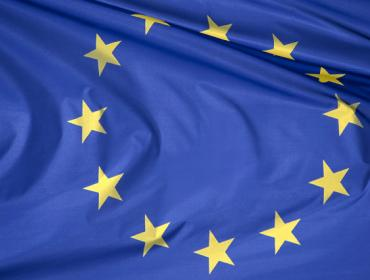 European blue flag with 12 yellow stars symbolising unity