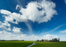 Typically Dutch landscape with clouds in the air